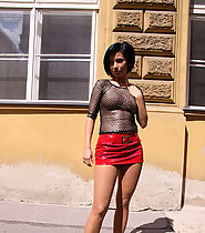 Sexy girl on the street flashing in pantyhose