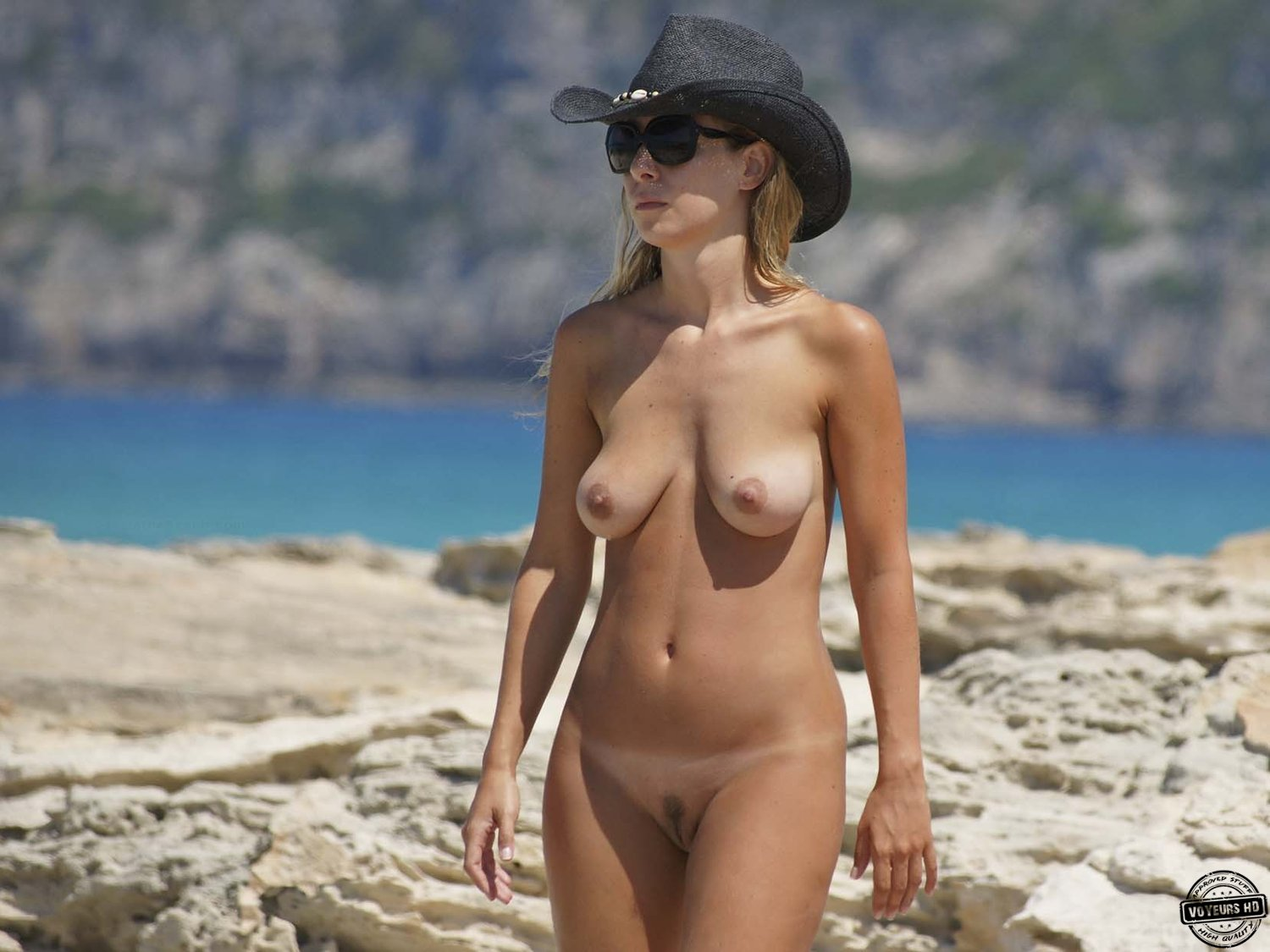 Spying on blonde with smooth body in beach cabin 9