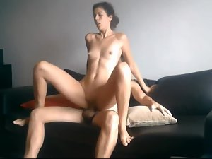 Sex with elegant woman on the sofa