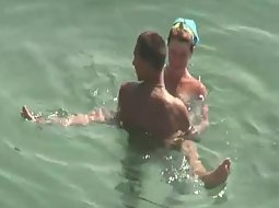 Couple caught trying sex in the water