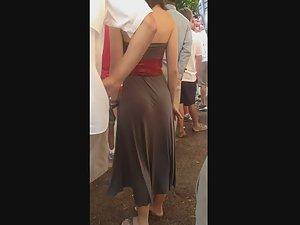 Beige dress puts her curvy figure on display