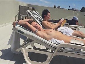 Sexy girl sunbathing naked on the terrace
