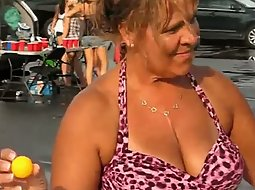 Mature lady playing beer pong