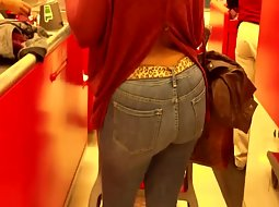 Woman's big butt on the cashier