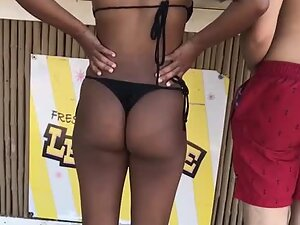 Noticeable black booty in a thong bikini