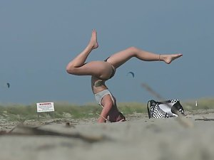 Peeping on fit girl doing yoga at the beach