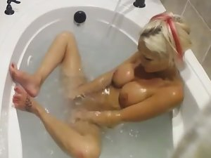 Gorgeous girl plays with water jets