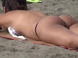 Hot beach girls in thong bikinis