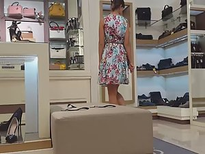Upskirt of teen girl trying shoes