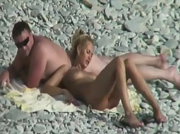 Interesting couple on the beach