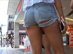 Hot girl in torn shorts