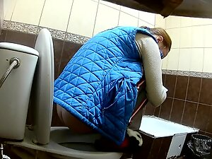Girl climbs on toilet seat when she is peeing