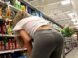 Fit girl bends over in supermarket