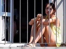 Hot girl smoking on the balcony