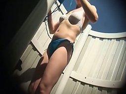 Cute girl puts a bikini on