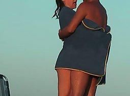 Nudist couple has fun with a towel