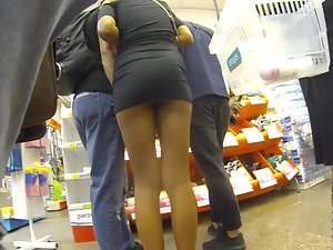 Too short miniskirt shows lots of incredible ass