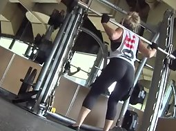 Sexy girls doing squats in the gym