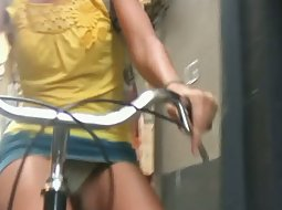 Clumsy girl on a bycicle