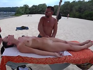 Hottest girl gets naked massage on beach