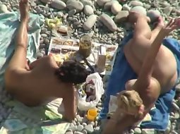Mature nudists spied on the beach