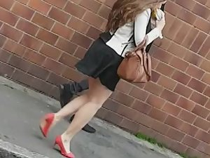 Stalking a teen girl in red high heel shoes