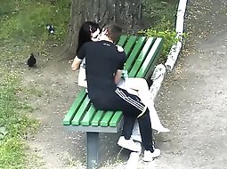 Teens making out in the park