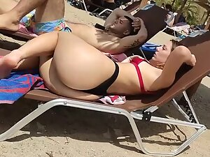 Bubble butt hanging out of a beach chair