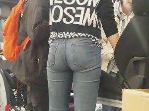Pretty store clerk in tight jeans