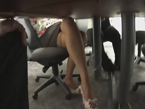 Spying sexy feet during business meeting