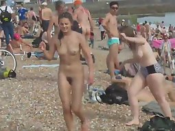 Nudist girls getting out of the sea