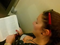 Busty girl reads in the train