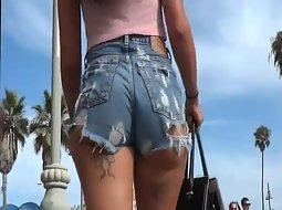 Tattooed girl walking in sexy shorts