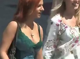 Zooming in on redheads boobs
