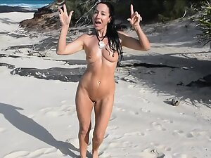 Naked gold digger singing and dancing on tropical beach