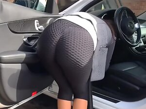 Hot woman looks like she is stuck in her car