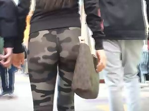 Camouflage tights couldn't hide her