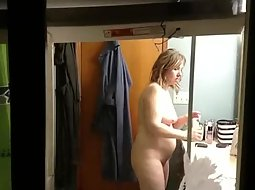 Chubby woman nude through window