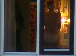 Watching her bathroom window