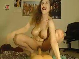 Wild cam girl rides a big dildo