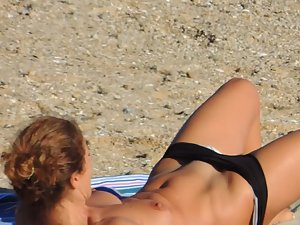 Spying on hot milf while she puts her bikini on