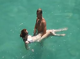 Hot couple playing in the water