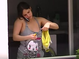 Hot neighbor hanging the clothes