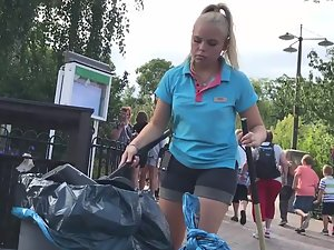 Sexy girl cleaning the park
