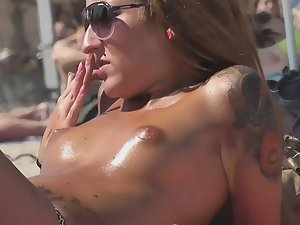 Sweaty oiled up tits of hot tattooed girl