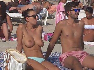 Big topless tits pressed during kiss