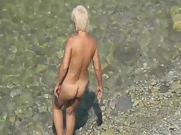 Watching a mature nudist woman