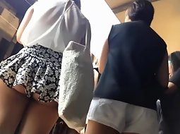 Cute girl's skirt is simply too short