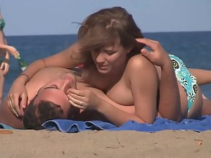 Cuddling and kissing with topless girl