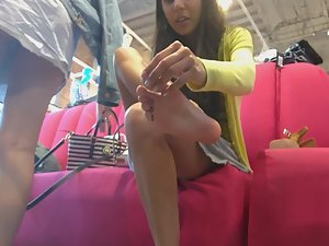 Upskirts and feet in shoe store